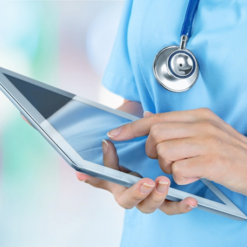 Nurse hands with a tablet